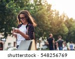 young woman texting while... | Shutterstock . vector #548256769
