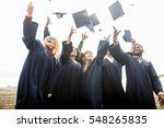 Small photo of education, graduation and people concept - group of happy international students in bachelor gowns throwing mortar boards up