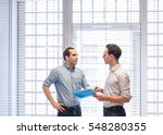 two colleagues speaking... | Shutterstock . vector #548280355