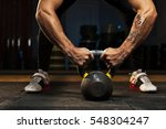 cropped shot of male muscular... | Shutterstock . vector #548304247