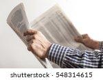 man reading newspaper on gray...   Shutterstock . vector #548314615