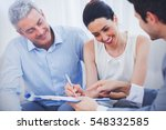 smiling woman sign on a contrat ... | Shutterstock . vector #548332585