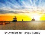 ship return to port at sunrise. | Shutterstock . vector #548346889