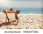 young businessman relaxing on... | Shutterstock . vector #548347381