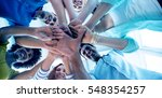 creative team putting their... | Shutterstock . vector #548354257