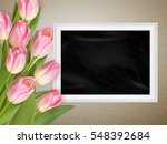 pink tulips with blank black... | Shutterstock .eps vector #548392684