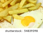 Plate Of French Fries And Eggs