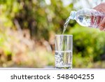 pouring water from bottle on...   Shutterstock . vector #548404255