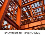 Red colored steel beam skeleton construction - stock photo