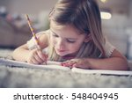 cute little girl  laying on... | Shutterstock . vector #548404945