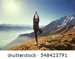 yoga in the mountains | Shutterstock . vector #548423791