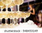 champagne glasses standing in a ... | Shutterstock . vector #548453149