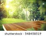 wooden desk in garden and free... | Shutterstock . vector #548458519