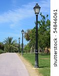 Line of lampposts along a park lane in a Spanish park. - stock photo