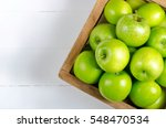 Apple On White Table Backgroun...