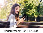 woman using smartphone in the... | Shutterstock . vector #548473435