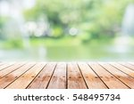 empty wooden table with party... | Shutterstock . vector #548495734