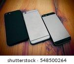three modern mobile phone.... | Shutterstock . vector #548500264