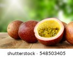 Small photo of Passion fruit on wooden table.