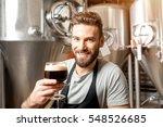 handsome brewer in uniform... | Shutterstock . vector #548526685