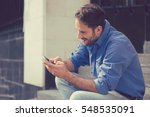 man texting on phone. casual... | Shutterstock . vector #548535091