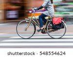 bicycle rider in the city in... | Shutterstock . vector #548554624
