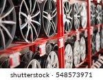 wheel rims on showcase | Shutterstock . vector #548573971