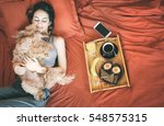 young woman is lying in bed... | Shutterstock . vector #548575315
