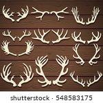 set of deer antlers on the... | Shutterstock .eps vector #548583175