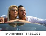 young couple leaning on a car | Shutterstock . vector #54861331