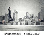 businessman with blindfolder on ... | Shutterstock . vector #548672569