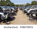 Two Rows Of Cars In A Salvage...