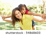 mother giving daughter ride on... | Shutterstock . vector #54868603