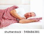 calm mature man sleep in bed   Shutterstock . vector #548686381