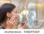 asian young woman putting blush ... | Shutterstock . vector #548695369