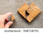 man held piece of tangram... | Shutterstock . vector #548718751