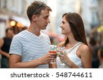 happy couple clangs their... | Shutterstock . vector #548744611