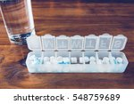 pill box with a drug on table | Shutterstock . vector #548759689