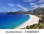 sweeping white beach with blue...   Shutterstock . vector #54880084