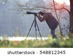 photographer in action with... | Shutterstock . vector #548812345