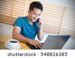 young man working on laptop and ...   Shutterstock . vector #548826385