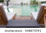 wood table and pool chair for... | Shutterstock . vector #548875591