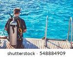 diver preparing to dive into... | Shutterstock . vector #548884909