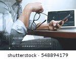 success businessman hand using... | Shutterstock . vector #548894179