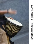 A Man Playing African Drum...