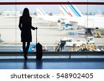 young woman in the airport ... | Shutterstock . vector #548902405