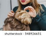 hairdresser makes upper bun...   Shutterstock . vector #548926651