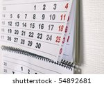 Calendar with dates of month is hanging on the wall - stock photo