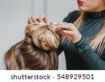 Hairdresser Makes Upper Bun...