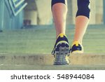 urban jogger on the staircase. | Shutterstock . vector #548944084